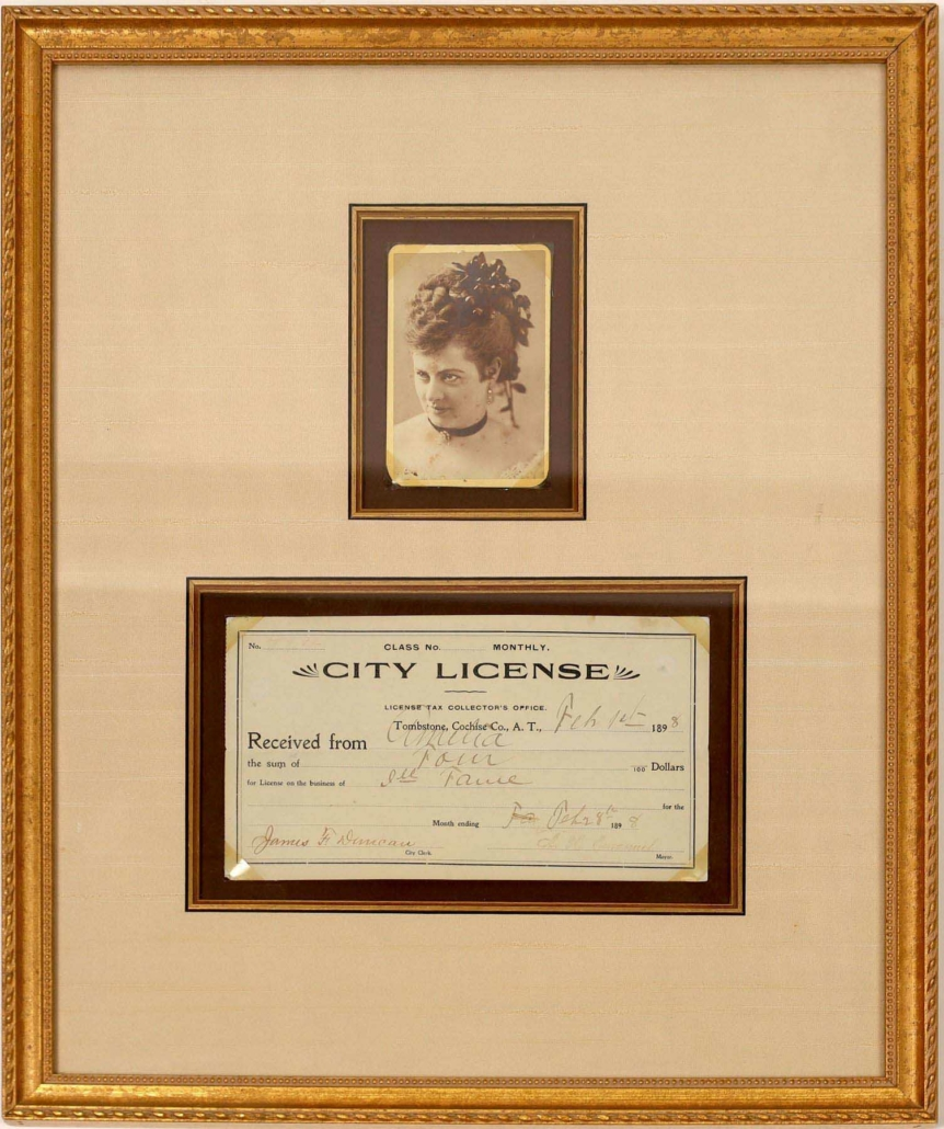 """Framed cabinet card photo of prostitute """"Amelia"""" with her business license, estimated at $5,000-$10,000"""