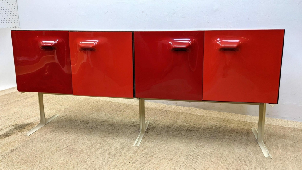 Raymond Loewy double-sided DF 2000 cabinet credenza bar complete with the original bottle storage trays, estimated at $3,000-$4,000