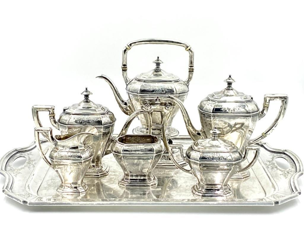 Reed and Barton sterling tea service with matching sterling silver tray, estimated at $4,000-$6,000