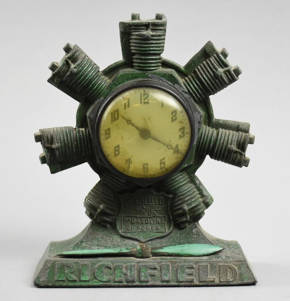 Circa-1920 Richfield Oil promotional desk clock with an aviation theme, estimated at $250-$500