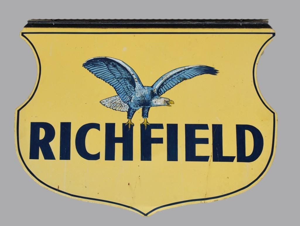 Richfield Oil double-sided sign, featuring the right facing eagle mascot logo, estimated at $200-$5,000