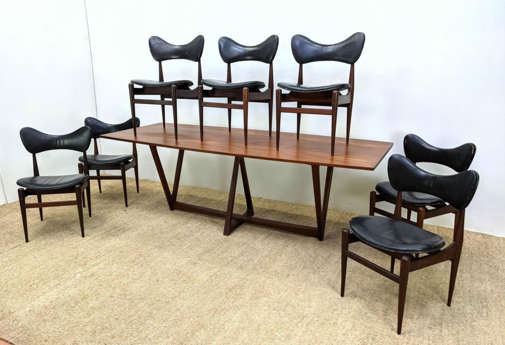 Inge and Luciano Rubino dining set of seven dining chairs plus a large table with inverted triangle bases, estimated at $5,000-$8,000