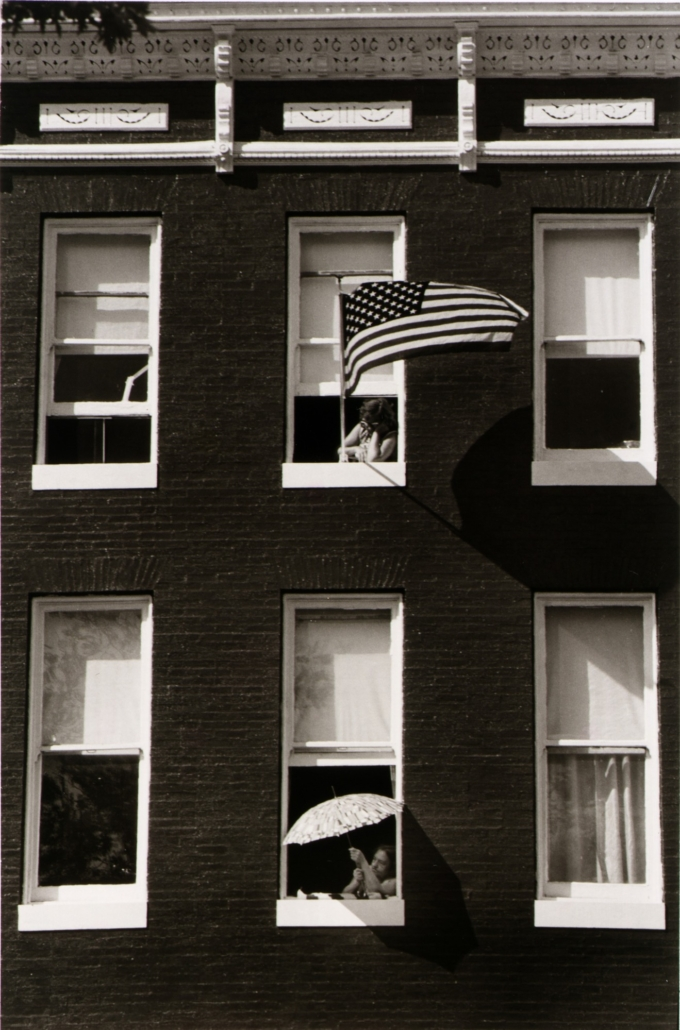 Joan Clark Netherwood, 'Two Viewers of the 'I Am an American Day' parade,' East Baltimore Street, 1977, gelatin silver print, Smithsonian American Art Museum, Transfer from the National Endowment for the Arts, 1983.63.998