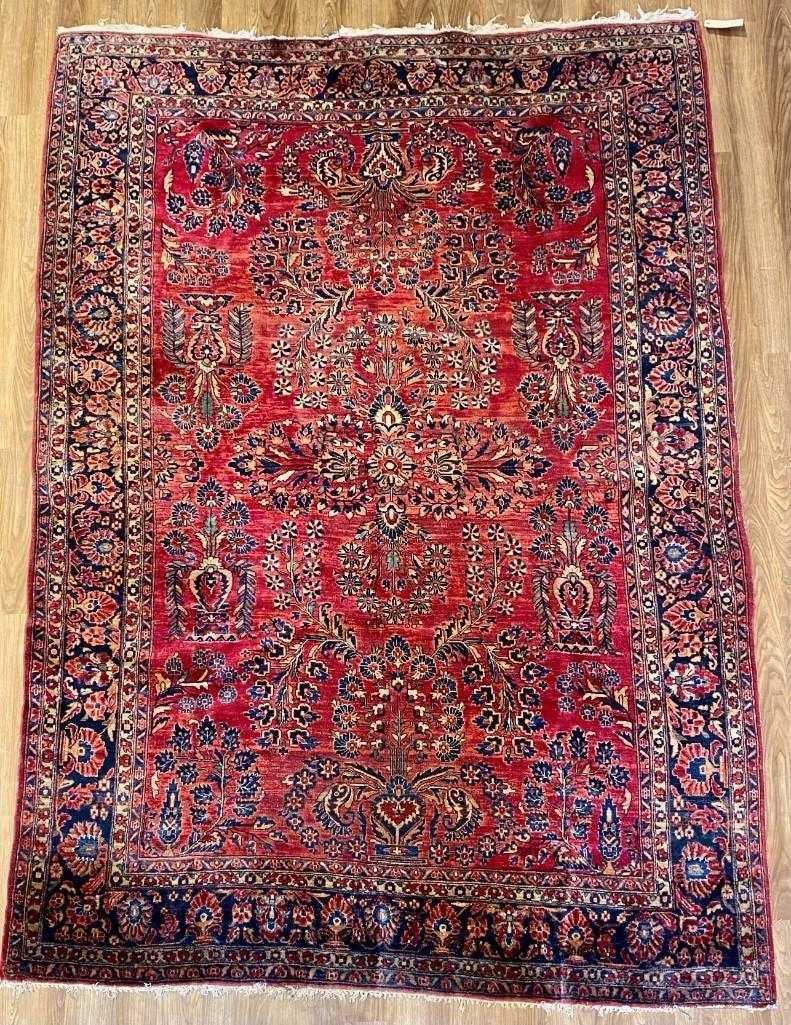 Handwoven wool antique Sarouk carpet, estimated at $2,000-$4,000