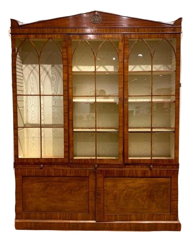 Regency secretary bookcase with a pull-out writing surface, estimated at $3,000-$5,000