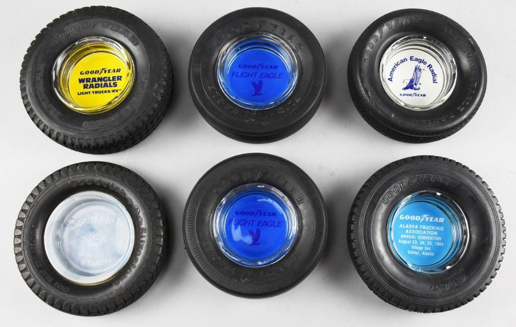 Group of tire-themed Goodyear advertising ashtrays, estimated at $100-$160