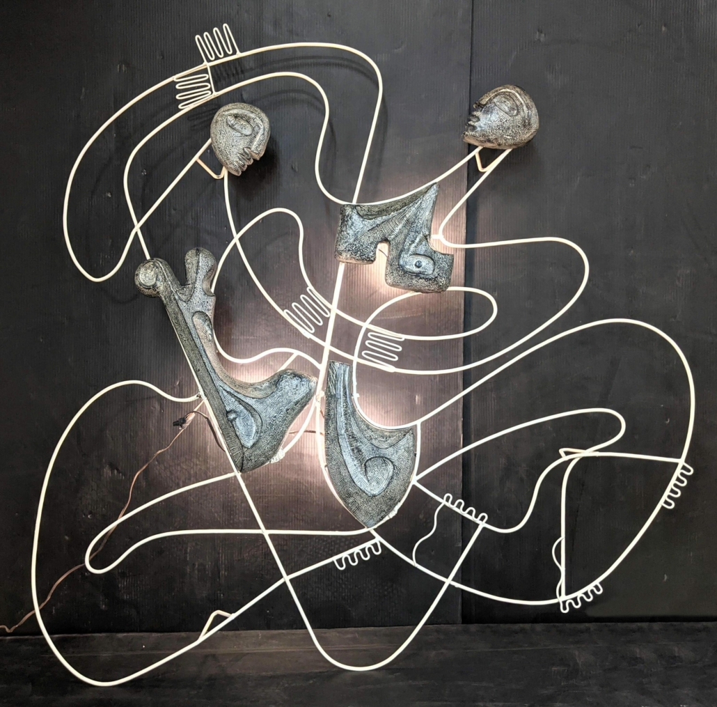 Figural wall sculpture by Frederick Weinberg that lights up, estimated at $3,000-$4,000