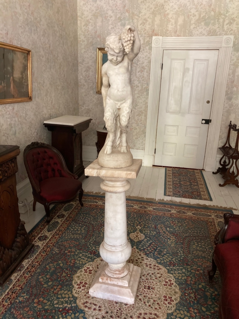 White marble statue of a fawn, estimated at $20,000-$35,000