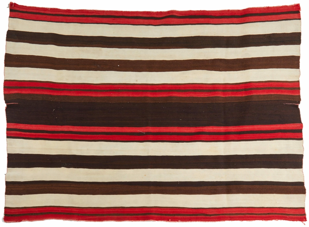A circa-1870 late-Classic First Phase Navajo wearing blanket sold for $14,000 plus the buyer's premium in May 2021.