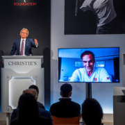 Jussi Pylkkanen, global president of Christie's, in conversation with Roger Federer during the June 23 Live Auction. Image courtesy of Christie's Images Ltd 2021