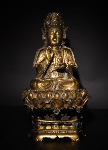 Chinese gilt bronze statue of Guanyin with a two-part stand from the Ming dynasty, estimated at $30,000-$45,000.