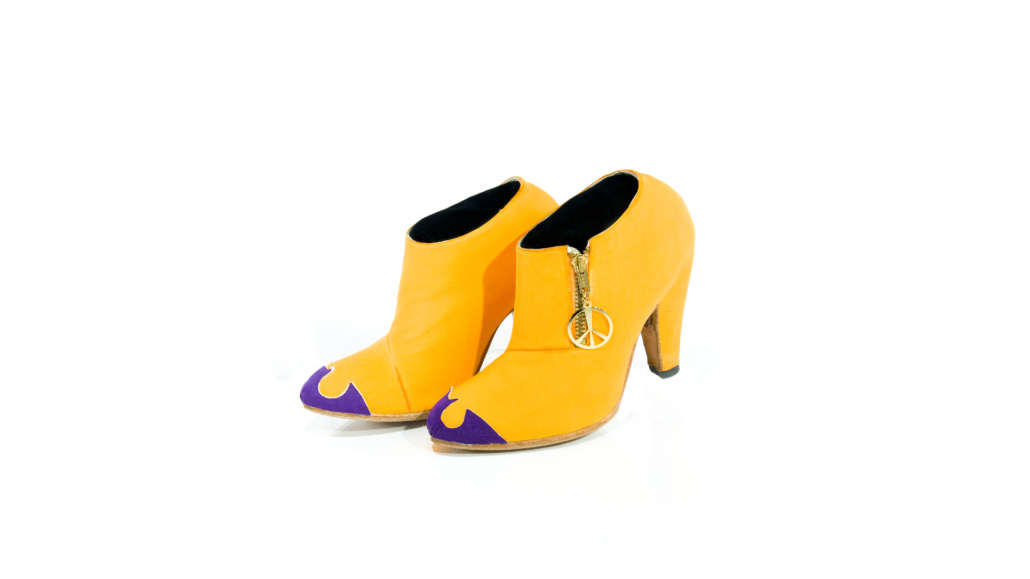 Following the wildly successful release of his 1989 Batman soundtrack album, most of Prince's shoes were in Joker colors (orange and purple) or Batman colors (black, gray and gold). Many pairs featured a Batman symbol on the toe, like this pair, which also sports a gold peace sign zipper pull. Photo credit: Tony Sylvers © 1985-2021 The Estate of Prince Rogers Nelson. All rights reserved.