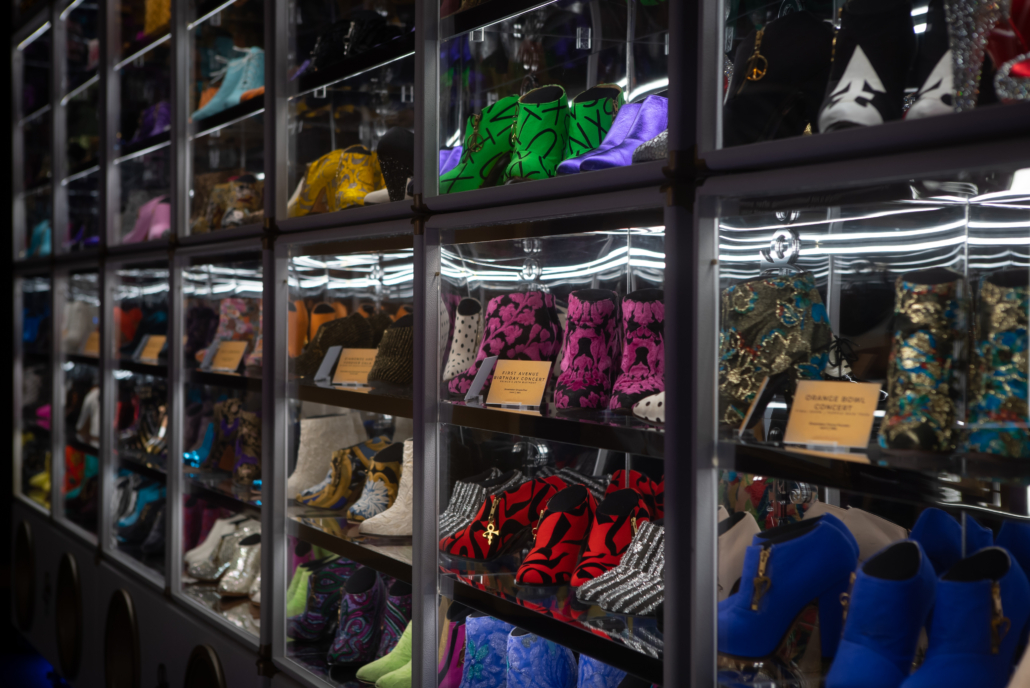 The Beautiful Collection exhibit features approximately 300 pairs of Prince's iconic shoes. Many are displayed in an eight-tiered display case made from repurposed guitar cases. Mirrors are used to enhance the exhibition experience and make the highest shelf viewable to all. Photo credit: Tony Sylvers © 1985-2021 The Estate of Prince Rogers Nelson. All rights reserved.