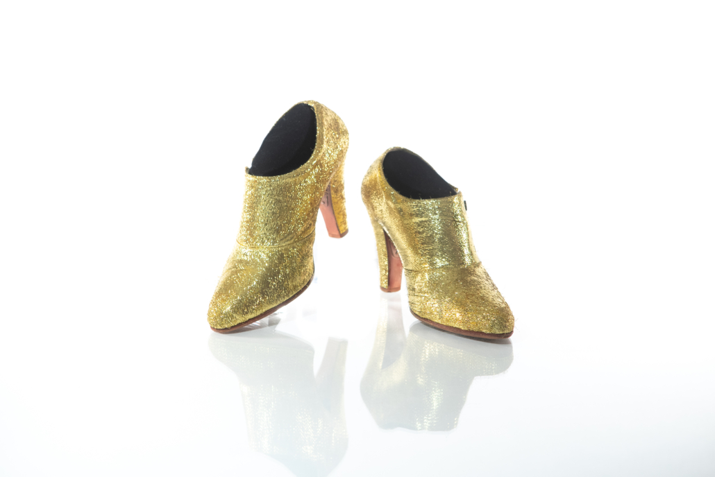 """Prince wore these gold metallic shoes during his 2010-2011 Welcome 2 America tour. All shows were performed on Prince's iconic Love Symbol stage and featured appearances by several guest stars, including Janelle Monae, Alicia Keys, and Questlove. The production toured throughout the United States before proceeding internationally, where each leg was marked by the """"Welcome 2"""" moniker, followed by the continent. Photo credit: Tony Sylvers. © 1985-2021 The Estate of Prince Rogers Nelson. All rights reserved."""
