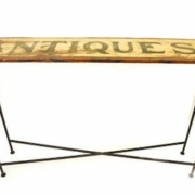 An upcycler transformed a sign into a console table that realized $200 plus the buyer's premium in June 2021 at Greenwich Auction. Photo courtesy of Greenwich Auction and LiveAuctioneers.