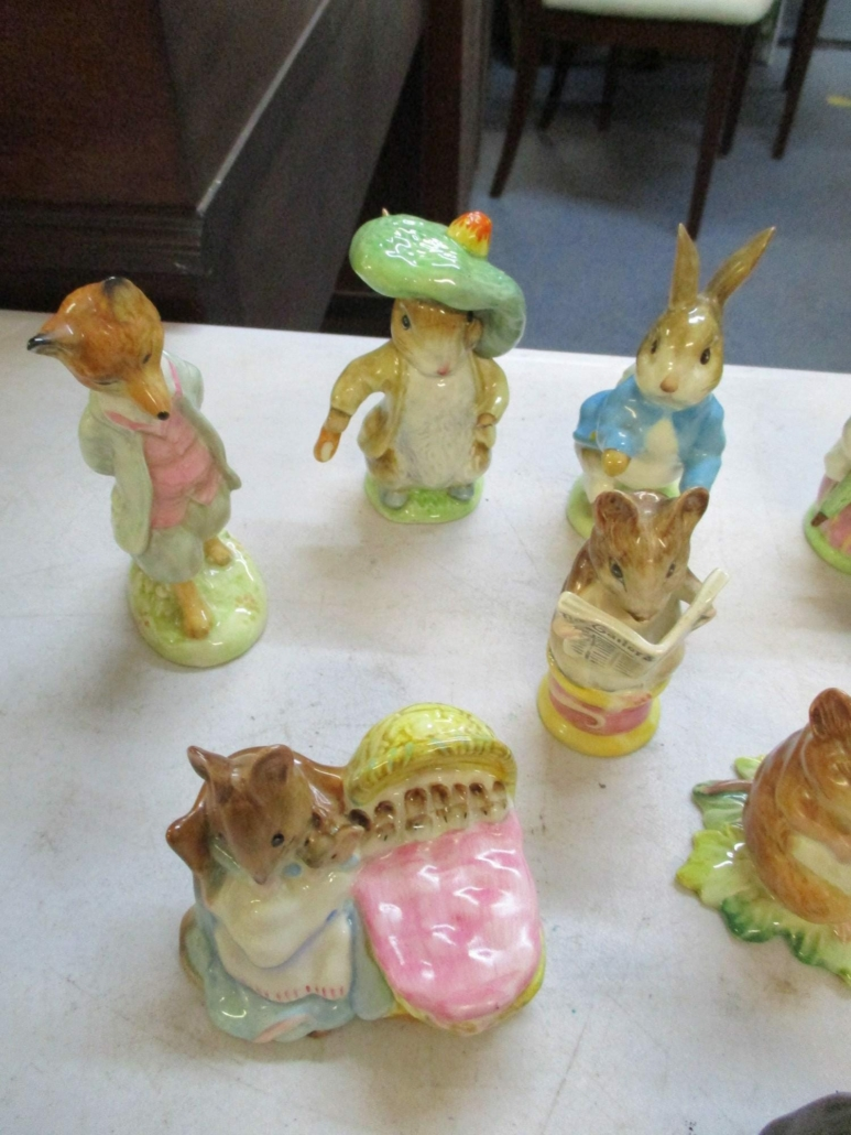 A baker's dozen of Beswick's Beatrix Potter porcelain figures, together with a Royal Copenhagen rabbit, earned $688 plus the buyer's premium in May 2021 at Bourne End Auction Rooms. Photo courtesy of Bourne End Auction Rooms and LiveAuctioneers.
