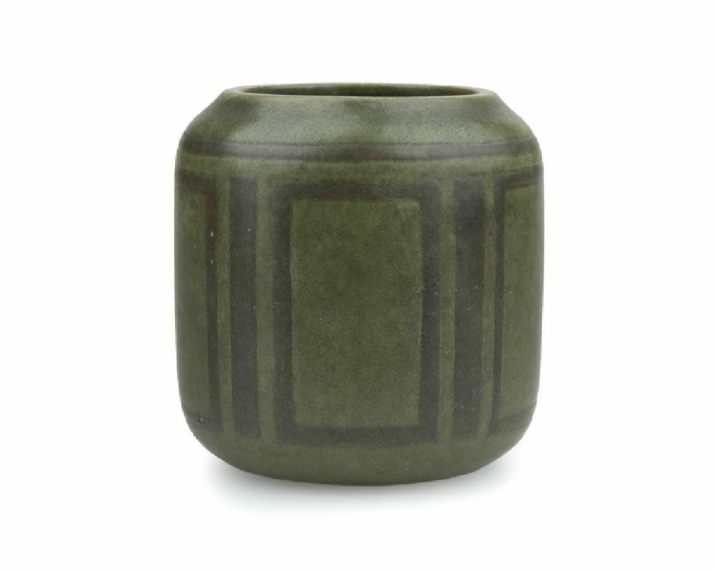 A two-tone green cylindrical Marblehead Pottery vase with slightly raised geometric designs brought $8,000 plus the buyer's premium in April 2017 at John Moran Auctioneers, Inc. Photo courtesy of John Moran Auctioneers, Inc. and LiveAuctioneers.