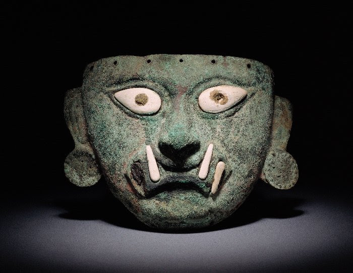 Copper funerary mask depicting Ai Apaec, the mythical Andean hero who guides visitors through the exhibit. It dates to between year 1 and year 800. Photo courtesy of World Heritage Exhibitions