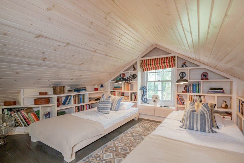 In addition to the master suite and a guest bedroom, a charming attic bedroom is perfect for children or additional guests. Photo credit: Richard Taverna for Sotheby's International Realty