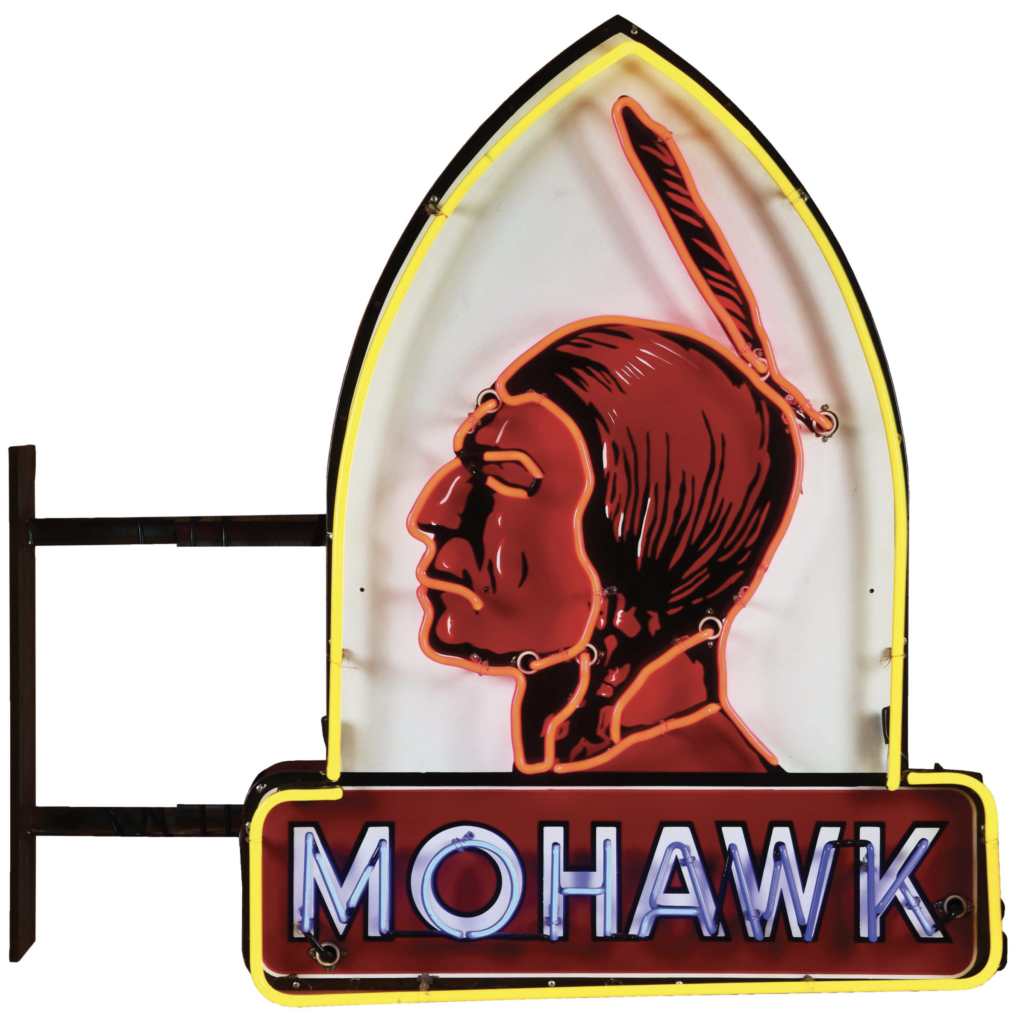 A double-sided Mohawk Gasoline neon and porcelain service sign was featured in an October 2021 auction and estimated at $20,000-$35,000. Image courtesy of Dan Morphy Auctions and LiveAuctioneers.