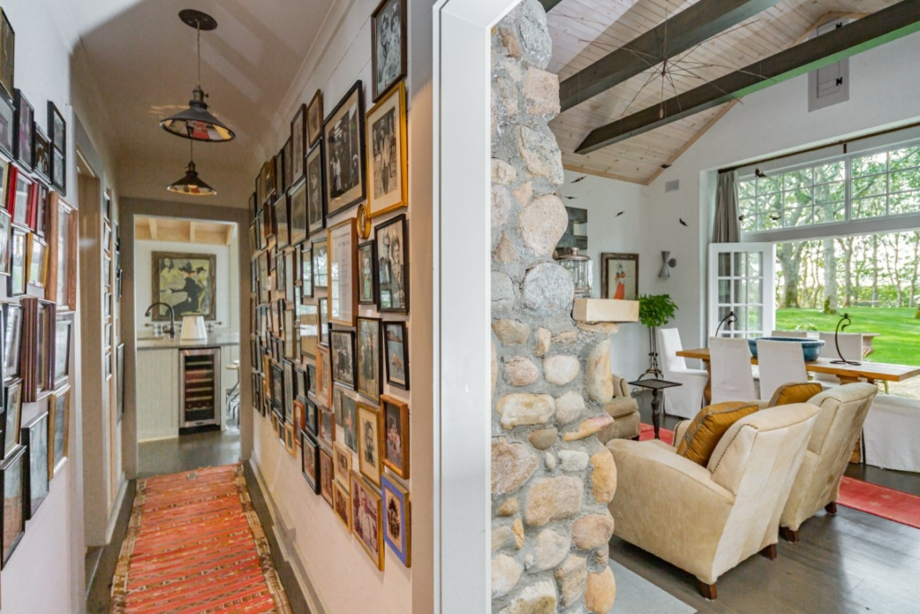 From the foyer are glimpses of the living room and hall with a family archive of photographs. Photo credit: Richard Taverna for Sotheby's International Realty