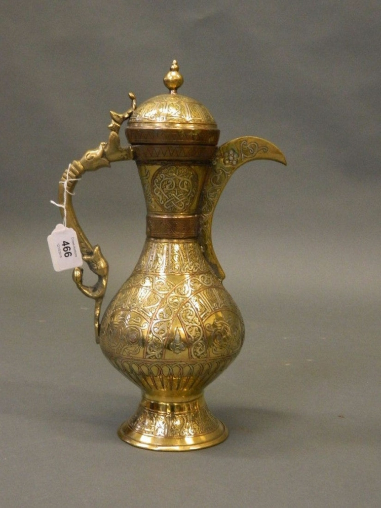 An Afghan brass ewer inlaid with silver and copper and decorated with Islamic script realized £120 ($166) plus the buyer's premium in 2016. Image courtesy of Crows Auction Gallery Ltd and LiveAuctioneers