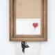 Banksy's 'Love is in the Bin,' 2018. Image courtesy of Sotheby's Ltd 2021.