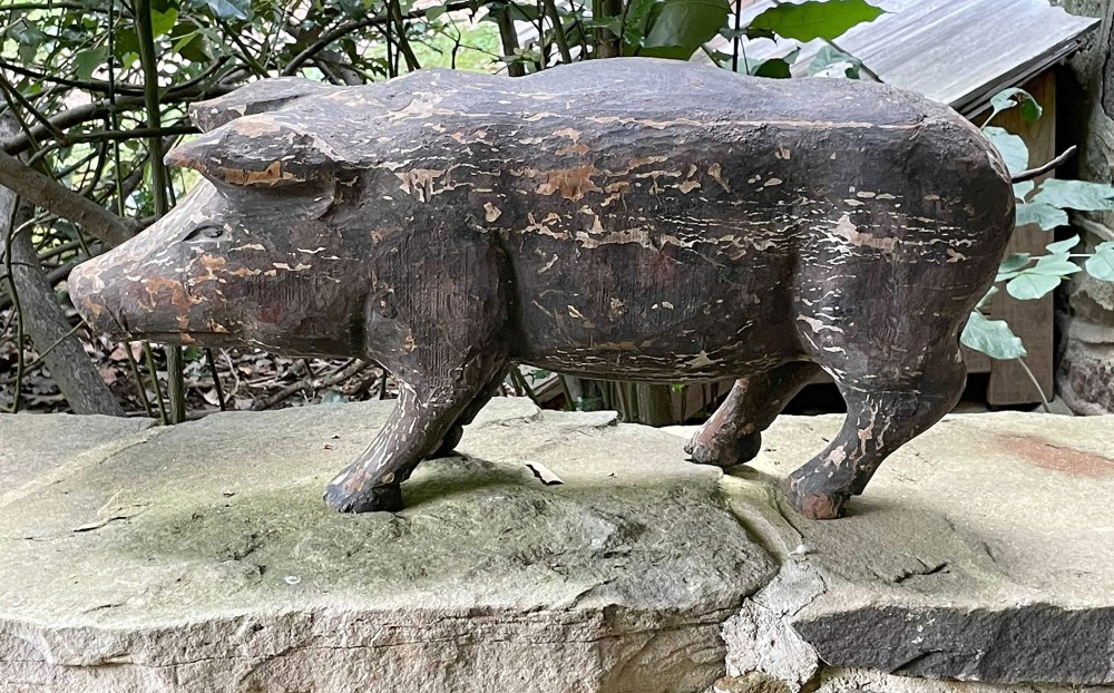 Wooden folk art sculpture of a standing pig, est. $400-$800