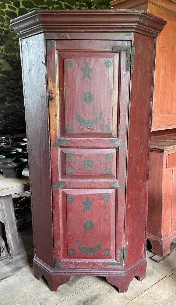 18th-century Pennsylvania red-painted corner cupboard, est. $3,000-$6,000