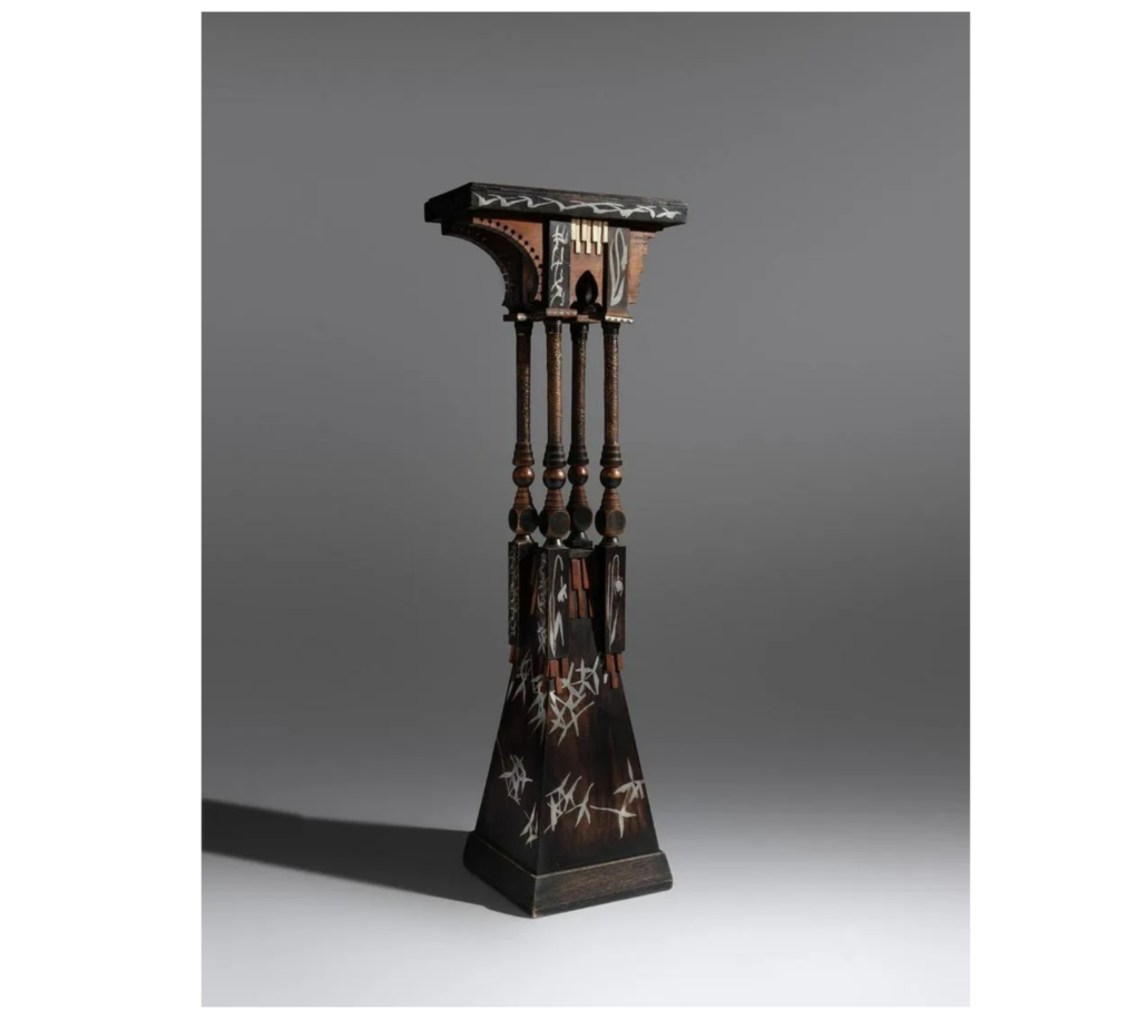An undated Carlo Bugatti pedestal table sold for $18,000 plus the buyer's premium in November 2019 at Hindman. Image courtesy of Hindman and LiveAuctioneers.