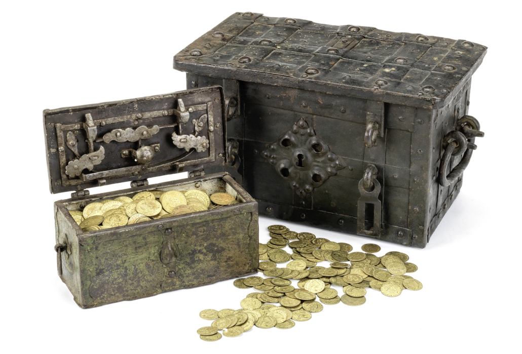 Pair of 18th-century iron strongboxes together with Victorian brass gaming counters, £2,800. Image courtesy of Bonhams