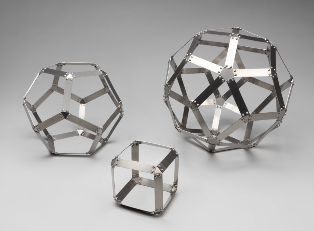 Dodecahedron, Hexahedron, and Rhombic Triacontahedron sculptures, c. 2019. Stacy Speyer. Laser cut stainless steel, hand bent, with stainless steel fasteners. Courtesy of the artist. L2021.0912.001-.03