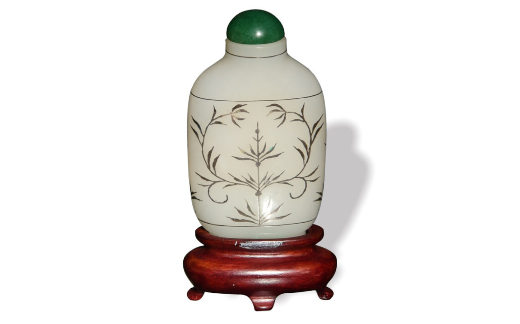 Chinese white jade snuff bottle with silver inlay, 18th century, est. $2,000-$3,000