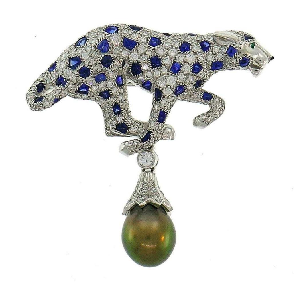 Cartier panthere pearl, diamond, sapphire and platinum pendant brooch, est. $50,000-$60,000