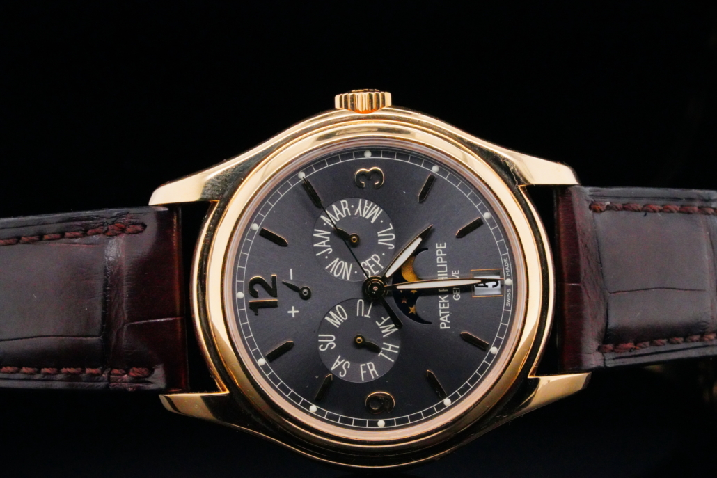 Patek Philippe include an 18K solid gold moon phase automatic watch with annual calendar, est. $48,000-$50,000