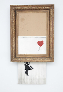 Banksy's 'Love is in the Bin,' which infamously shredded itself during a live Sotheby's auction in 2018, returned to Sotheby's and sold for $25.3 million. Image courtesy of Sotheby's
