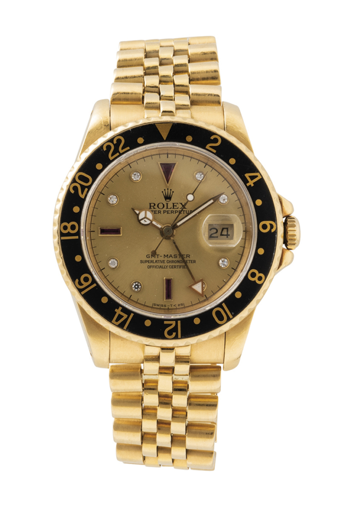 Rolex 18K gold Ref. 16758 Serti Dial GMT Master wristwatch with box and papers, est. $30,000-$40,000. Image courtesy of Skinner, Inc.